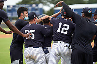 FCL Yankees Madison Santos (34) is mobbed by teammates after hitting a walk-off double during a game against the FCL Phillies on July 6, 2021 at the Yankees Minor League Complex in Tampa, Florida.  (Mike Janes/Four Seam Images)