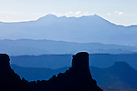 Finally the blue haze of summer is put to good use as different horizons step to the La Sal Mountains near Moab.