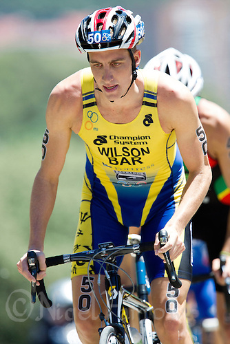 02 JUN 2013 - MADRID, ESP - Jason Wilson (BAR) of Barbados on the bike during the men's ITU 2013 World Triathlon Series round in Casa de Campo, Madrid, Spain (PHOTO (C) 2013 NIGEL FARROW)