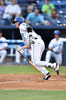 Asheville Tourists first baseman Taylor Snyder (28) swings at a pitch during a game against the Charleston RiverDogs at McCormick Field on July 5, 2017 in Asheville, North Carolina. The RiverDogs defeated the Tourists 10-9. (Tony Farlow/Four Seam Images)