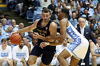 CHAPEL HILL, NC - NOVEMBER 06: John Mooney #33 of the University of Notre Dame drives against Garrison Brooks #15 of the University of North Carolina during a game between Notre Dame and North Carolina at Dean E. Smith Center on November 06, 2019 in Chapel Hill, North Carolina.