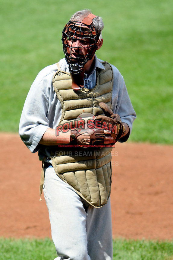 A member of the Providence Grays vintage Base Ball team during a game versus the Olneyville Cadets, played prior to a game between the Indianapolis Indians and the Pawtucket Red Sox at McCoy Stadium in Pawtucket, Rhode Island on May 19, 2013.  (Ken Babbitt/Four Seam Images)
