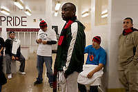 Coach Willie Rhines speaks to members of the Fort Belknap College Eagles men's basketball team in a locker room at Harlem High School on the night before the team hosted the 2010 Fort Belknap College Round Robin Tournament at the high school in Harlem, Montana, USA.