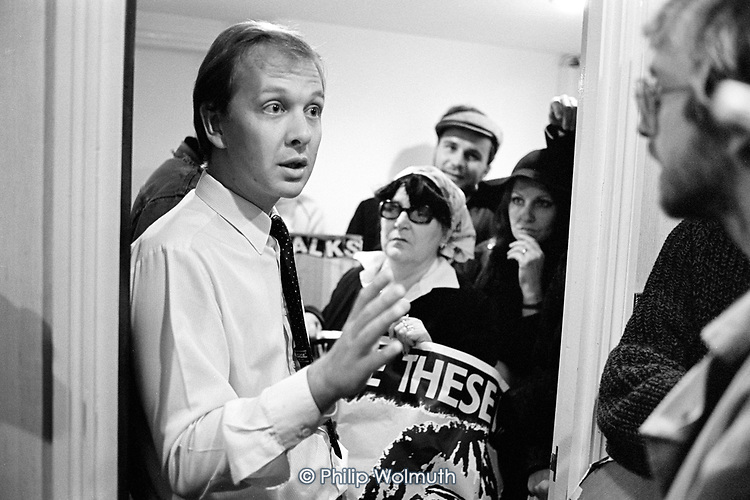 Lee Goldstone of the Regalian Property Company talks with members of the Walterton and Elgin Action Group during an unannounced visit to the company's offices to protest at its involvement with the proposed sale of the estates by Westminster City Council, London 1987.