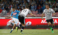 Calcio, Serie A: Napoli vs Juventus. Napoli, stadio San Paolo, 26 settembre 2015. <br /> Napoli's Lorenzo Insigne, left, is challenged by Juventus' Leonardo Bonucci, center, and Simone Padoin during the Italian Serie A football match between Napoli and Juventus at Naple's San Paolo stadium, 26 September 2015.<br /> UPDATE IMAGES PRESS/Isabella Bonotto