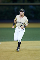 Chris Lanzilli (24) of the Wake Forest Demon Deacons round the bases after hitting a 2-run home run against the Liberty Flames at David F. Couch Ballpark on April 25, 2018 in  Winston-Salem, North Carolina.  The Demon Deacons defeated the Flames 8-7.  (Brian Westerholt/Four Seam Images)