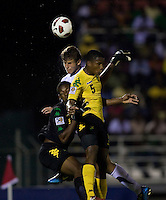 Zachary Carroll (17) of the United States goes up for a header with Alvas Powell (5) and Richard Trench (1) of Jamaica during the semifinals of the CONCACAF Men's Under 17 Championship at Catherine Hall Stadium in Montego Bay, Jamaica. The United States defeated Jamaica, 2-0.