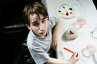 Josh Bukowski works on some arts and crafts at the Share and Care Network's annual retreat held in Montauk, NY on March 18, 2003.