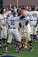 Michigan Wolverines designated hitter Jimmy Obertop (8) hugs teammate Joe Pace (32) after his ninth inning game winning walk-off 2 run home run against the Michigan State Spartans on March 21, 2021 in NCAA baseball action at Ray Fisher Stadium in Ann Arbor, Michigan. Michigan scored 8 runs in the bottom of the ninth inning to defeat the Spartans 8-7. (Andrew Woolley/Four Seam Images)