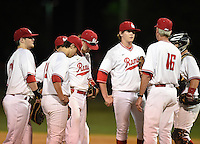 Lake Mary Rams coach Ed Nuss (16) talks with the team including (L-R) Jacob Corso (24), Brett Brubaker (19), Brendan Rodgers (3), Nikolas Kovach (12), Bradley Nenna (10) game against the Lake Brantley Patriots on April 2, 2015 at Allen Tuttle Field in Lake Mary, Florida.  Lake Brantley defeated Lake Mary 10-5.  (Mike Janes/Four Seam Images)