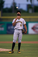 Bradenton Marauders pitcher Brennan Malone (22) flips the ball during a game against the Dunedin Blue Jays on May 15, 2021 at BayCare Ballpark in Clearwater, Florida. Malone earned the hold of a combined no-hitter with Jose Maldonado, Cameron Junker, and Wandi Montout. (Mike Janes/Four Seam Images)