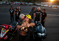 Nov 17, 2019; Pomona, CA, USA; NHRA pro stock motorcycle rider Jianna Salinas celebrates with crew after winning the Auto Club Finals at Auto Club Raceway at Pomona. Mandatory Credit: Mark J. Rebilas-USA TODAY Sports