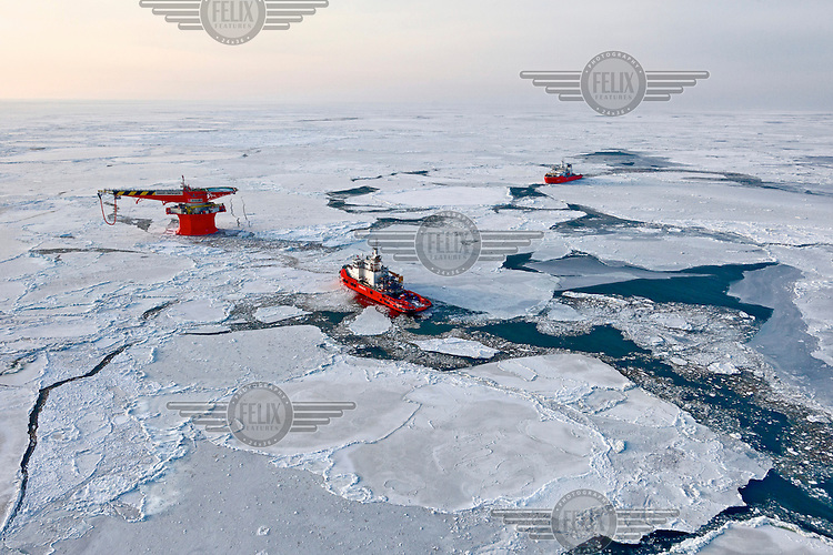 An aerial view of the world's most northerly oil terminal (according to the Guiness Book of Records). The LUKoil terminal, off Russia's Arctic shore, serves tankers using the Arctic route between Europe and Asia. /Felix Features