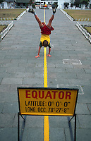 Boy straddling the equator, Quatorial Monument, Quito, Ecuador