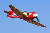 """Owner and pilot Mike Brown flies his highly modified Hawker Sea Fury """"September Fury"""" into the Valley of Speed during the 2006 Reno Championship Air Races. September Fury took the 2006 Unlimited Championship with a speed of 481.619 mph over the 67.29 mile course. Photographed 09/06"""
