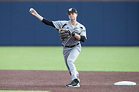 Western Michigan Broncos second baseman Jimmy Allen (11) makes a throw to first base against the Michigan Wolverines on March 18, 2019 in the NCAA baseball game at Ray Fisher Stadium in Ann Arbor, Michigan. Michigan defeated Western Michigan 12-5. (Andrew Woolley/Four Seam Images)