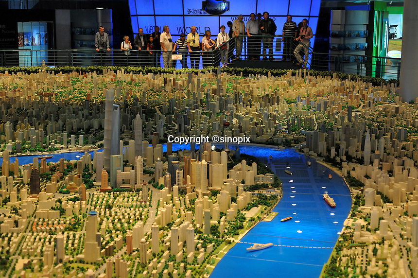A future map of Shanghai at the Shanghai Urban Planning Exposition Center. The scale model took three years to build and cost around a million US$. .26 Oct 2009