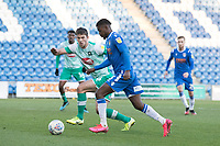 Theo Robinson of Colchester United heads for goal under pressure from Niall Canavan of Plymouth Argyle during Colchester United vs Plymouth Argyle, Sky Bet EFL League 2 Football at the JobServe Community Stadium on 8th February 2020