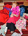 Ten-year-old Catie Hynes, who has been treated for osteosarcoma, a type of bone cancer, poses in an oversized ladies dress, shoes and hat to help highlight Give Up Clothes For Good, the UKs biggest clothing collection, urging grown-ups across Scotland to clear out their wardrobes and give up their clothes to raise £2.5m to help more children like him beat cancer.