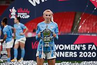 1st November 2020; Wembley Stadium, London, England; Womens FA Cup Final Football, Everton Womens versus Manchester City Womens; Chloe Kelly of Manchester City Women posing with the Womens FA Cup Final trophy