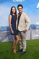 "LOS ANGELES - JUL 15:  Caitlin McHugh, John Stamos at Disney+ ""Turner & Hooch"" Premiere Event at Westfield Century City Mall on July 15, 2021 in Century City, CA"