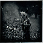 JULY 1995    -  Melbourne, Australia   -  A groundskeeper at the Maroondah Dam burns some tree clippings.