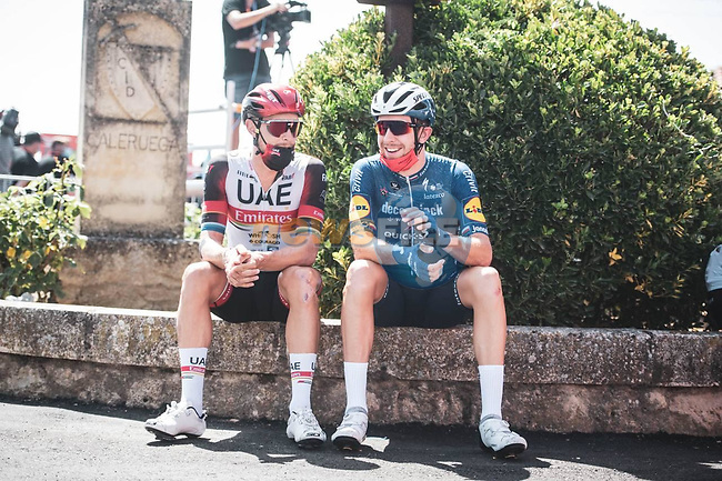 UAE Team Emirates and Deceuninck-Quick Step riders relax before the start of Stage 2 of La Vuelta d'Espana 2021, running 166.7km from Caleruega. VIII Centenario de Santo Domingo de Guzmán to Burgos. Gamonal, Spain. 15th August 2021.    <br /> Picture: Unipublic/Charly Lopez | Cyclefile<br /> <br /> All photos usage must carry mandatory copyright credit (© Cyclefile | Unipublic/Charly Lopez)