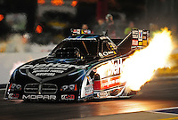 Sept. 16, 2011; Concord, NC, USA: NHRA funny car driver Matt Hagan on his way to the first sub 4 second run at 1000 feet in a funny car during qualifying for the O'Reilly Auto Parts Nationals at zMax Dragway. Mandatory Credit: Mark J. Rebilas-US PRESSWIRE