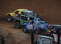 Mar. 20, 2011; Chandler, AZ, USA;  LOORRS pro two driver Rob Naughton (54) leads Jeremy McGrath (2) and Robby Woods (99) during round two at Firebird International Raceway. Mandatory Credit: Mark J. Rebilas-