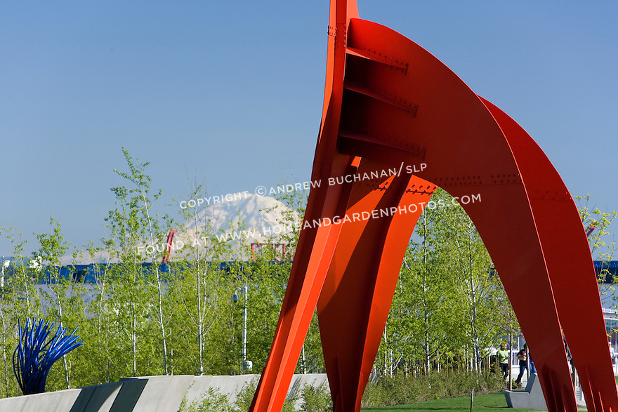 """With snow-capped Mt. Rainier looming some 60+ miles away, the vivid red of Alexander Calder's, """"Eagle, 1971"""" contrasts with the vivid blue of a Northwest sky.  SAM's Olympic Sculpture Park, Seattle, WA."""