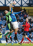 Bilel Mohsni rises to challenge keeper Neil Parry and scores the equaliser for Rangers