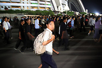 North Koreans walk outside the MayDay stadium in Pyongyang after a performance.