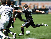 DC United's Chris Pontius takes a shot on goal. LA Galaxy defender Tony Sanneh. The LA Galaxy and DC United play to 2-2 draw at Home Depot Center stadium in Carson, California on Sunday March 22, 2009.