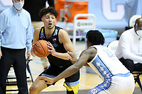 CHAPEL HILL, NC - FEBRUARY 24: Dawson Garcia #33 of Marquette is defended by Day'Ron Sharpe #11 of North Carolina during a game between Marquette and North Carolina at Dean E. Smith Center on February 24, 2021 in Chapel Hill, North Carolina.