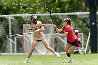 NEWTON, MA - MAY 14: Charlotte North #8 of Boston College takes a shot as Maggie Reynolds #28 of Fairfield University defends during NCAA Division I Women's Lacrosse Tournament first round game between Fairfield University and Boston College at Newton Campus Lacrosse Field on May 14, 2021 in Newton, Massachusetts.