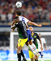 DALLAS, TX - JULY 25: Nicholas Gioacchini #8 of the United States heads the ball over Damion Lowe #17 of Jamaica during a game between Jamaica and USMNT at AT&T Stadium on July 25, 2021 in Dallas, Texas.