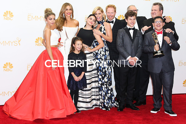 LOS ANGELES, CA, USA - AUGUST 25: Actresses Sarah Hyland, Sofía Vergara, Aubrey Anderson-Emmons, Julie Bowen and Ariel Winter, Actors Jesse Tyler Ferguson, Nolan Gould, Rico Rodriguez, Eric Stonestreet and Ed O'Neill, winners of the Outstanding Comedy Series Award for 'Modern Family' pose in the press room at the 66th Annual Primetime Emmy Awards held at Nokia Theatre L.A. Live on August 25, 2014 in Los Angeles, California, United States. (Photo by Celebrity Monitor)