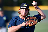 First baseman Dash Winningham (34) of the Columbia Fireflies warms up before a game against the Greenville Drive on Wednesday, June 14, 2017, at Fluor Field at the West End in Greenville, South Carolina. Columbia won, 6-2, in 11 innings. (Tom Priddy/Four Seam Images)