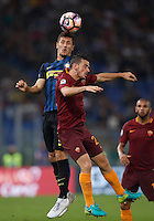 Calcio, Serie A: Roma vs Inter. Roma, stadio Olimpico, 2 ottobre 2016.<br /> FC Inter's Stevan Jovetic, left, and Roma's Alessandro Florenzi jump for the ball during the Italian Serie A football match between Roma and FC Inter at Rome's Olympic stadium, 2 October 2016.<br /> UPDATE IMAGES PRESS/Isabella Bonotto