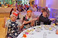 Pictured: Guests at the table.  Wednesday 28 November 2018<br /> Re: National Lottery millionaires from south Wales and the south west of England have hosted a glitzy Rat Pack-inspired Christmas party for an older people's music group at The Bear Hotel in Cowbridge, Wales, UK.