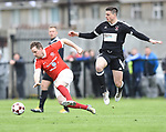 Colin Ryan of Newmarket Celtic in action against Niall Hanley of Janesboro during their Munster Junior Cup semi-final at Limerick. Photograph by John Kelly.