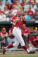 Arkansas Razorbacks first baseman Clark Eagan (9) follows through on his swing against the Virginia Cavaliers in Game 1 of the NCAA College World Series on June 13, 2015 at TD Ameritrade Park in Omaha, Nebraska. Virginia defeated Arkansas 5-3. (Andrew Woolley/Four Seam Images)