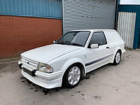BNPS.co.uk (01202 558833)<br /> Pic: HampsonAuctions/BNPS<br /> <br /> Pictured: 1985 Ford Escort 1.6 Turbo Estate.<br /> <br /> Since the 1990s, Geoff Barlow, 46, has collected dozens of classic cars from an Escort Mexico replica to several types of Transit, Cortina, and Sierra.<br /> <br /> However, he still regrets selling the first car which inspired his passion, a 1980 Escort Mark 2 he bought from his sister in 1992.  <br /> <br /> Geoff's fascination with Fords gathered pace in the last decade and he 'lost control,' buying as many Fords as he came across and saving them from disrepair.