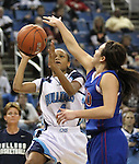 Centennial's Shelby Valentine shoots in a semi-final game at the NIAA 4A State Basketball Championships between Centennial and Reno high schools at Lawlor Events Center in Reno, Nev, on Thursday, Feb. 23, 2012. Reno won 60-41. .Photo by Cathleen Allison