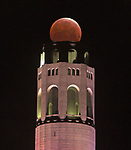 Photo of the total lunar eclipse over San Francisco's Coit Tower that took place early Tuesday morning  5/26 that showed the moon bathed in an eerie reddish glow, as it passed through Earth's shadow.