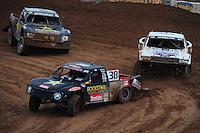 Mar. 20, 2011; Chandler, AZ, USA;  LOORRS pro two driver Brian Deegan (38) leads Carl Renezeder (17) and Rob MacCachren during round two at Firebird International Raceway. Mandatory Credit: Mark J. Rebilas-