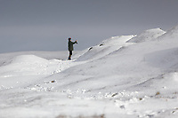 WEATHER PICTURE WALES<br /> Pictured: A woman takes a selfie on the snow covered Black Mountains near Brynamman, Wales, UK. Wednesday 23 January 2019