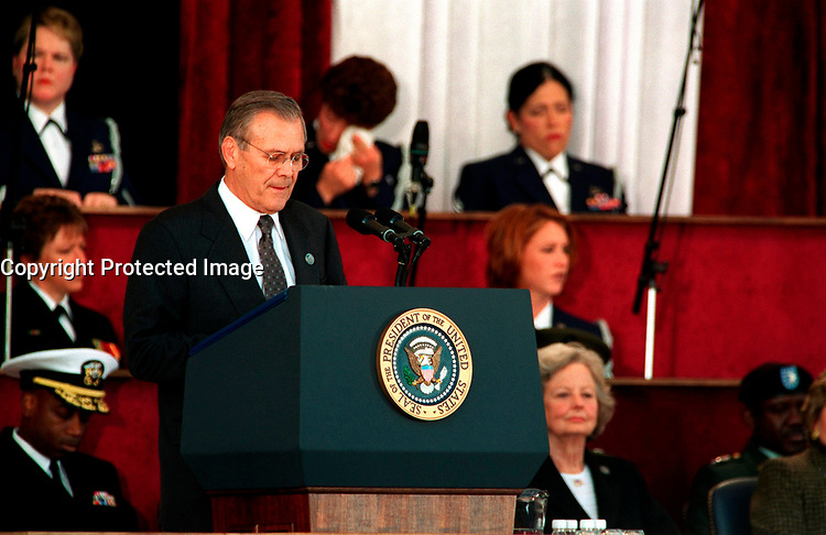 Oct 11, 2001, Washington, DC, United States<br /> <br /> Secretary of Defense Donald H. Rumsfeld addresses the audience at the Pentagon on Oct. 11, 2001, during a memorial service in honor of those who perished in the terrorist attack on the building.  President George W. Bush, Rumsfeld and Chairman of the Joint Chiefs of Staff Gen. Richard B. Myers, U.S. Air Force, eulogized the 184 persons killed when a terrorist hijacked airliner was purposely crashed into the southwest face of the building on Sept. 11, 2001. <br /> <br /> Mandatory Credit: Photo by DoD photo by Helene C. Stikkel.(Released)-