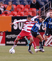 FC Dallas forward Ramon Nunez fights off a challenge by Colorado captain and defender Pablo Mastroeni. The Colorado Rapids drew 0-0 with FC Dallas in the first game of the Western Conference Semi-finals Invesco Field at Mile High, Denver, Colorado, September 22, 2005.