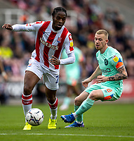 11th September 2021;  Bet365 Stadium, Stoke, Staffordshire, England; EFL Championship football, Stoke City versus Huddersfield Town; Romaine Sawyers of Stoke City under pressure from Lewis O'Brien of Huddersfield Town